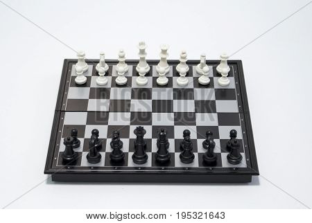 Chess black player side on white background. Table game chess photo. Chess figures position for game start. Chessboard with figures. Business strategy concept. Tactic decisions competition game chess