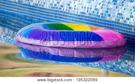 Inflatable balloon on the water in the pool .