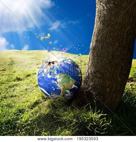 conceptual image of world on green landscape.