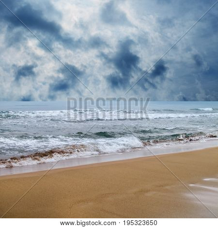 seascape image of waves on sea over stormy sky