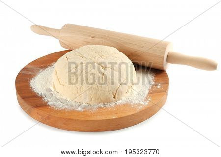 Cutting board with ball of raw dough and rolling pin on white background