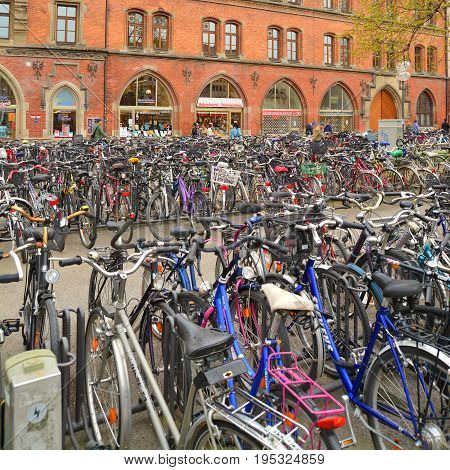 Munich Germany April 25 2015: Many bicycles parked on a square near the center of Munich Germany. Shot taken on April 25th 2015