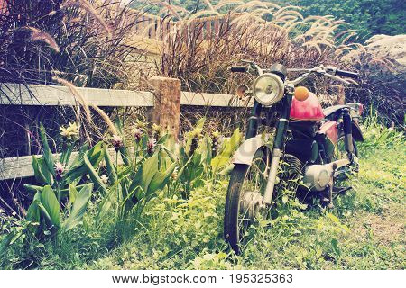 Classic Motorbike in countryside. The Vintage old motorcycle.