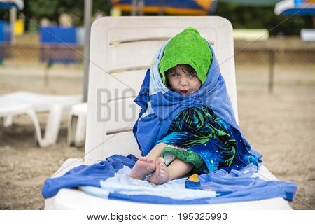 The Little Girl Wrapped In Towels For Warming, Facial Expressions