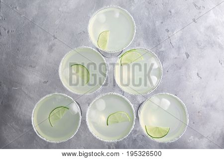 Delicious cocktail with tequila and lime on table
