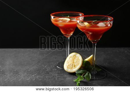 Delicious cocktails with tequila on black background