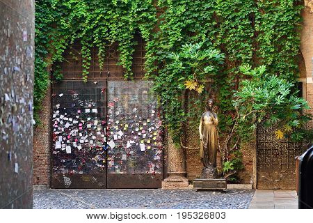 VERONA ITALY - MAY 2017: Patio and statue Juliet Verona Italy. Very popular tourist place.