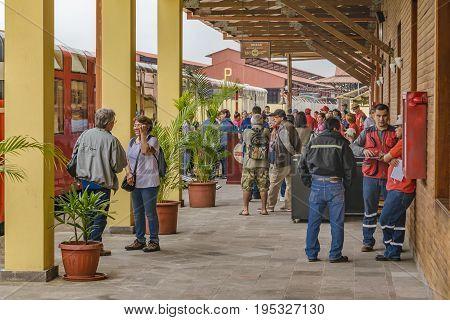 DURAN, ECUADOR, OCTOBER - 2016 - Group of people waiting the touristic train at small station in Duran town Ecuador