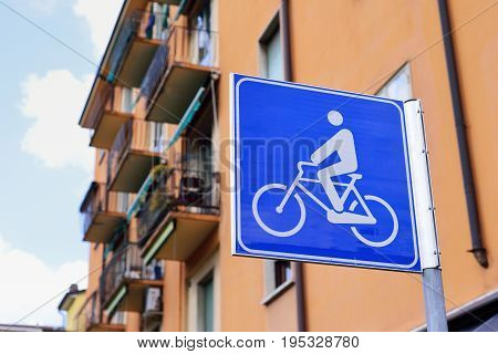 Blue bicycle lane sign. The concept of safe traffic.