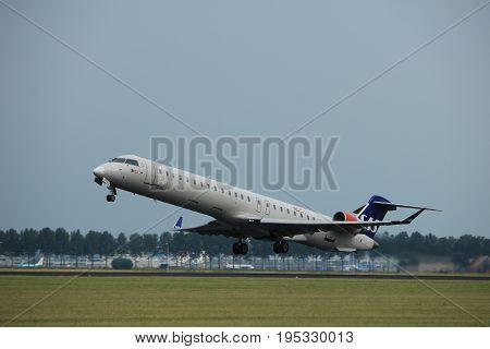 Amsterdam the Netherlands - July 6th 2017: OY-KFE SAS Scandinavian Airlines Canadair CRJ-900 takeoff from Polderbaan runway Amsterdam Schiphol Airport
