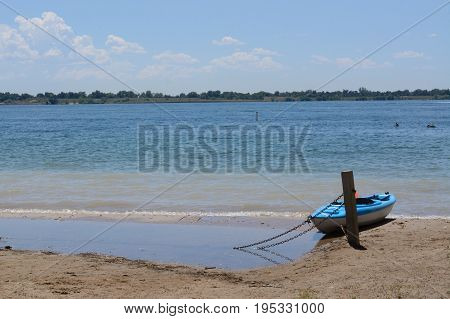 Kayak on shore of lake at Standley Lake Regional Park in Westminster Colorado