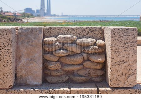 Roman old stone wall decoration in caesarea Archaeological site close to Herod the Great hippodrome