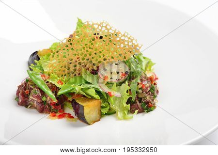 Creative salad with tartar beef eggplant. White background menu concept.