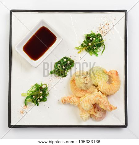 Tempura shrimps and vegetables with soy sauce deep fried shrimps on white background