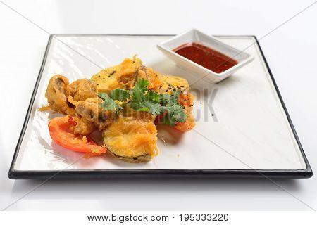 Baked vegetables in batter. White background menu concept.
