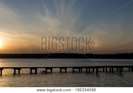 Sunset over Necko lake and bridge. podlasie, Poland.