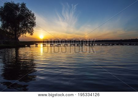 Sunset over Necko lake and bridge, podlasie, Poland.