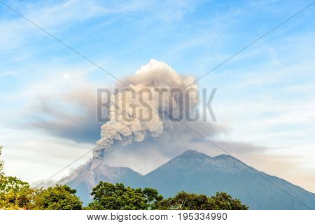 Smoke billows from erupting Fuego volcano next to Acatenango volcano just after dawn near Antigua, Guatemala, Central America