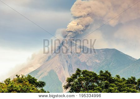 Smoke billows from erupting Fuego volcano just after dawn near Antigua, Guatemala, Central America