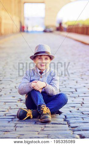 happy stylish boy   in the city street