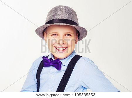happy child wearing a hat, isolated against white
