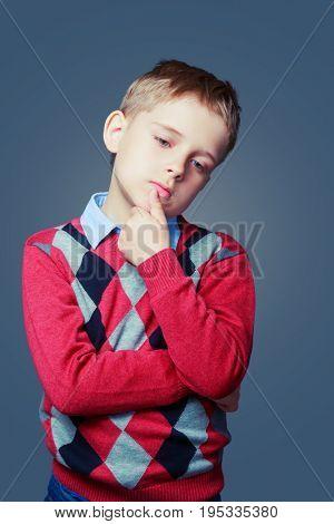thoughtful sad boy isolated against grey background
