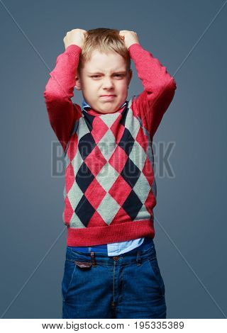 unhappy angry boy isolated against grey background