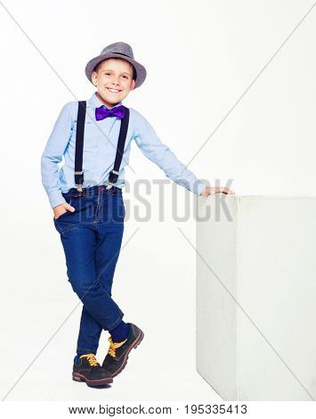happy stylish boy wearing a hat, isolated