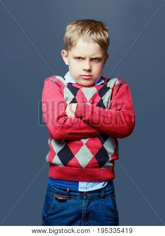 angry boy isolated against grey background