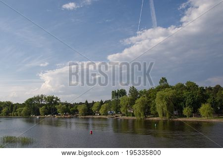 Clouds over Netta river in Augustów, Poland