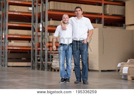 Portrait of independent designers in their furniture manufacturing workshop, looking relaxed and confident