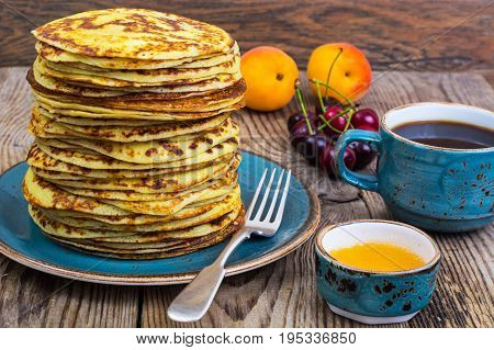 High stack of pancakes in rustic style. Studio Photo