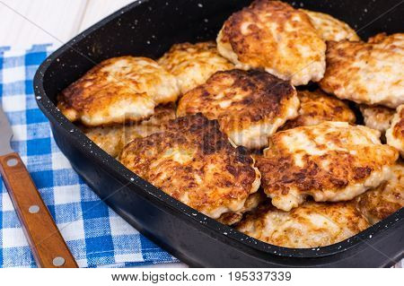 Fried chopped cutlets in frying pan. Studio Photo