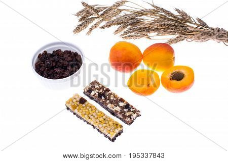 Cereal bars with raisins and fruits for diet and fitness meals. Studio Photo