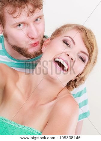 Loving Couple Man Kissing His Girlfriend In Cheek