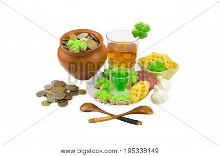 glass of whiskey for a dessert green liquor a festive table decorated with garlic and appetizers and coins. Saint Patrick's Day