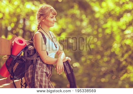 Young Woman With Backpack Hiking In Forest Trail