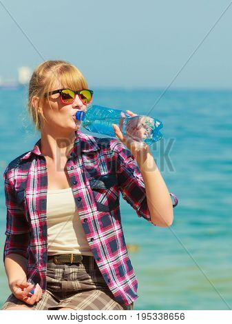 Young Woman Drinking Water Outdoor