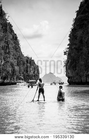 EL NIDO PALAWAN PHILIPPINES - JANUARY 17 2017: Black and white picture of a woman practcing stand up paddle in El Nido.