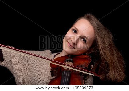 Smiling Woman Playing Violin On Black Background