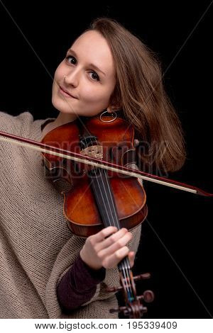 Smiling Young Woman With A Violin On Black