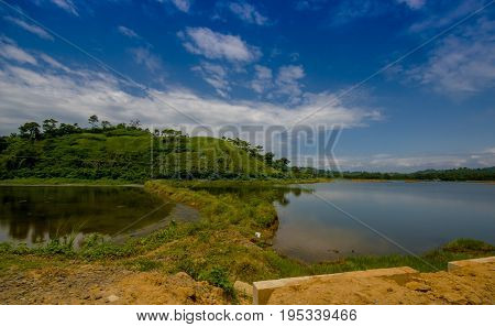 Lake in in the coast of Same, surrounded with abundat vegetation in a sunny day in the Ecuadorian coasts.