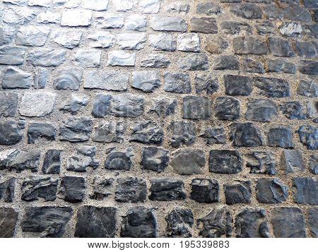A stone walking  pathway embedded in cement in Switzerland.