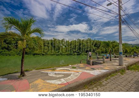 ATACAMES, ECUADOR - March 16, 2016: Unidentified man enjoying the view near of a river in Atacames, Ecuador.