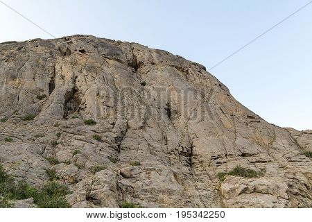 High mountain with smooth walls and uneven top unapproachable majestic