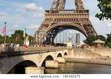 PARIS, FRANCE - JUNE 24, 2017: View of the famous Eiffel Tower in Paris. France. The Eiffel Tower was constructed from 1887-1889 as the entrance to the 1889 World's Fair by engineer Gustave Eiffel.