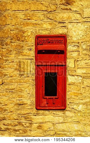 Old Red Letterbox In The Wall, Traditional Way Of Delivering Letters To The Post Office