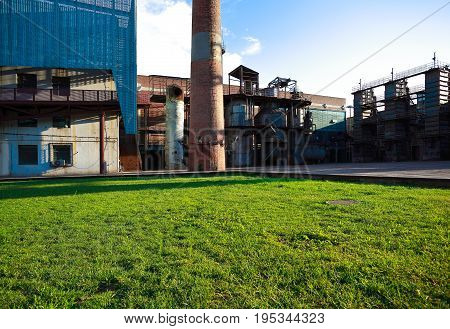 Empty grass with old abandoned closed steel steelworks of pipelines