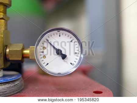 Part of equipment working meter pressure gauge with an arrow in the left sector