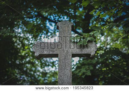 stone cross on grave gravestone on cemetery